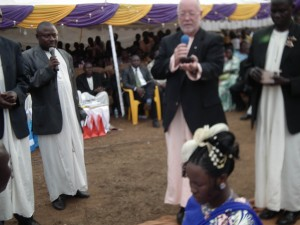 Ron blessing rings at an Introduction Ceremony